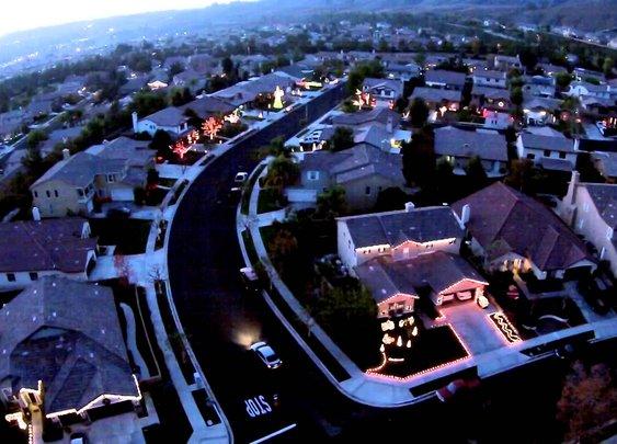 An Intense Christmas Light Show Synchronized Across a Suburban Block