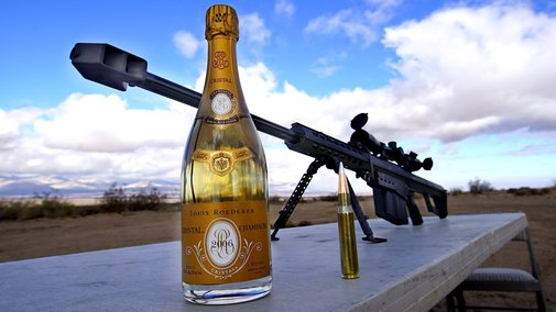 Gun Expert Skillfully Uncorks a Bottle of Champagne With a .50 Caliber Rifle