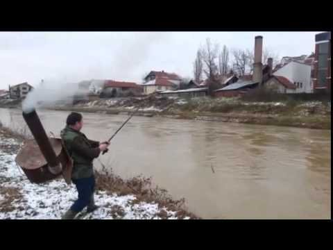 A Fisherman Battles Cold Weather in Serbia by Attaching a Large Metal Stove to His Back