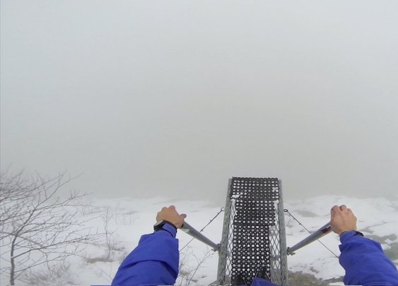 First-Person Video of a BASE Jumper Leaping Off a Cliff Into a Mysterious Foggy Void