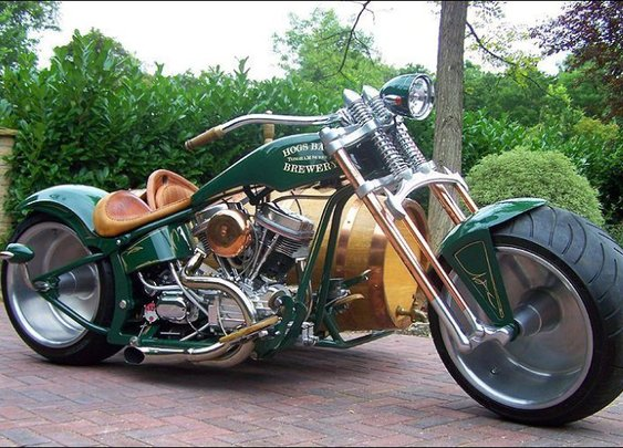 A Specialty Motorcycle With a Beer Barrel for a Sidecar and an Onboard Bar