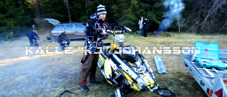 Guy Rides Snowmobile Over Rapids and up a Waterfall Video