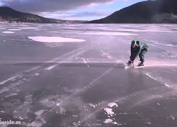 An Ice Skater Propels Himself Along the Surface of a Frozen Lake With a Chainsaw