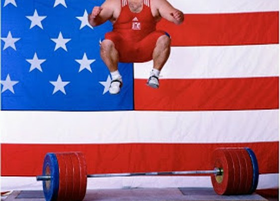: American weightlifter Shane Hamman celebrating with a jump