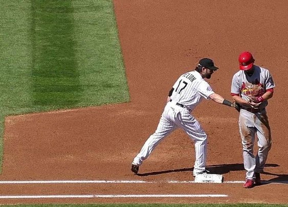 Helton pulls off hidden-ball trick on pickoff
