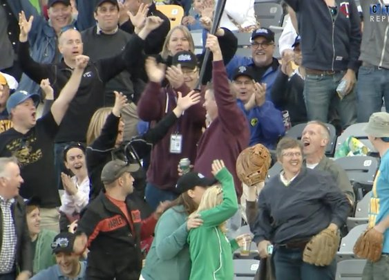 A Baseball Fan Makes an Incredible One-Handed Catch After a Bat Goes Flying Into the Stands Without Dropping His Beer