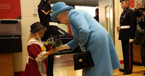 Soldier accidentally hit a little girl in the face while saluting the Queen