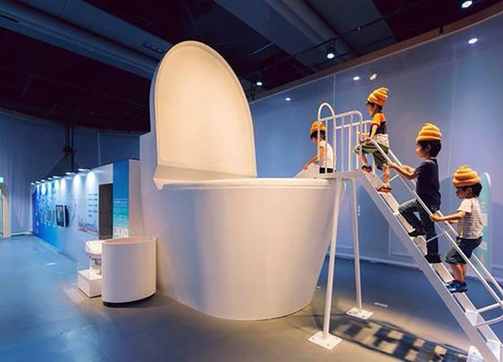 Tokyo kids wear turd hats and jump into giant loo to learn how toilets work