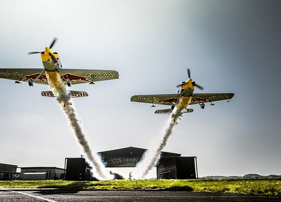 Two British Pilots Record World First by Flying Their Planes in Formation Through a 25-Foot High Hangar at 185 MPH