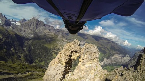 GoPro: Wingsuit Flight Through 2 Meter Cave - Uli Emanuele - YouTube