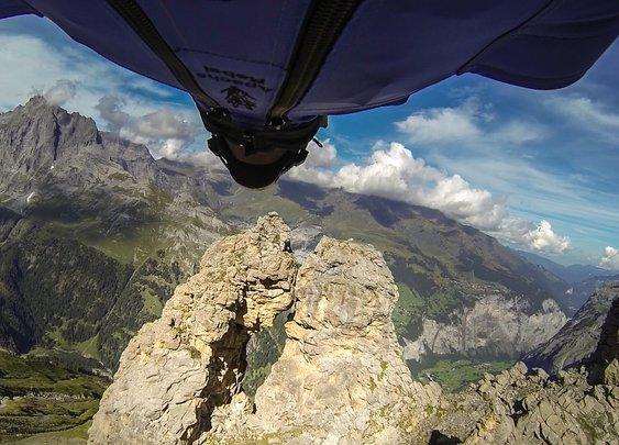 GoPro: Wingsuit Flight Through 2 Meter Cave - Uli Emanuele - YouTube