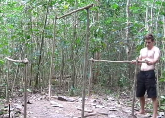 Watch This Guy Build An Amazing Shelter In The Woods Using Only Dirt, Trees, And Rocks