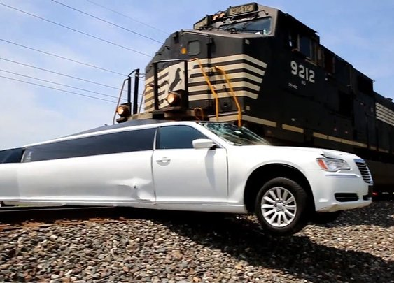 Video: 10,000 tonne freight train ploughs into limousine at level crossing - Telegraph