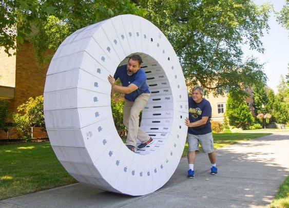 iWheel, A Giant Human Hamster Wheel Created Using 36 Empty iMac Boxes