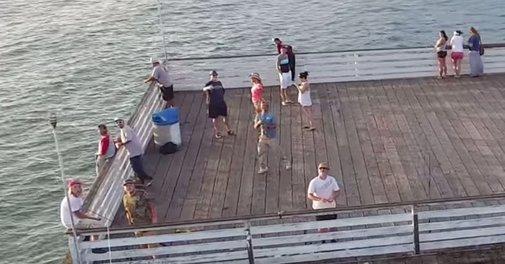 Fisherman hooks a drone midflight