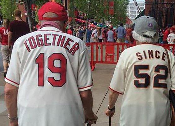 Elderly couple wears matching jerseys to baseball game
