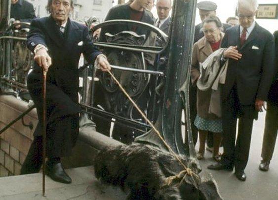 """Salvador Dali taking his anteater for a walk in Paris"""