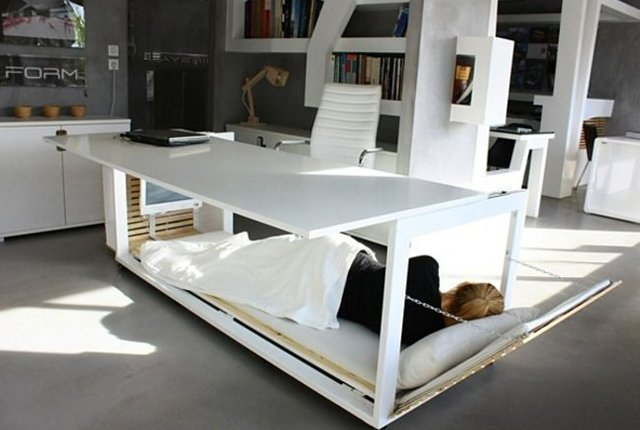 Power Nap in the Office Like a Pro With This Desk That Turns Into a Bed | Mental Floss
