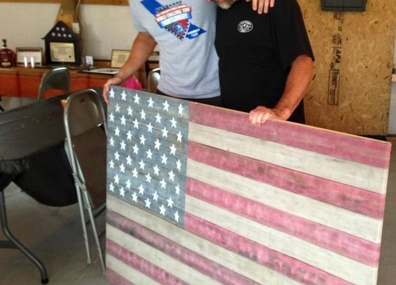 Firefighter's Retirement Present: American Flag Made Entirely From Firehose