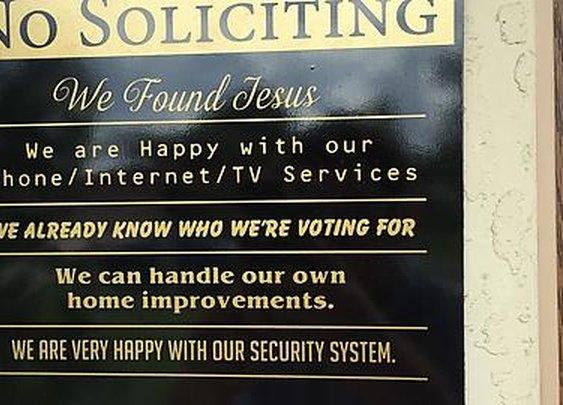 Funny front door sign.