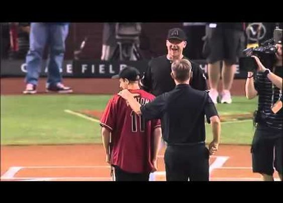 Blind Kid Throws his very first pitch, pretty cool
