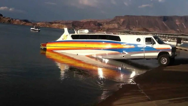 A Unique RV/Boat Hybrid 'BoaterHome' Vehicle Launches at a Boat Ramp in Front of Amazed Onlookers