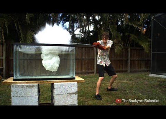 An Experiment Pouring Molten Kosher Salt Into a Tank of Water Resulting In a Series of Explosions
