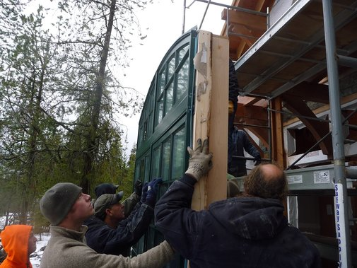 How many does it take to manually install a large window?