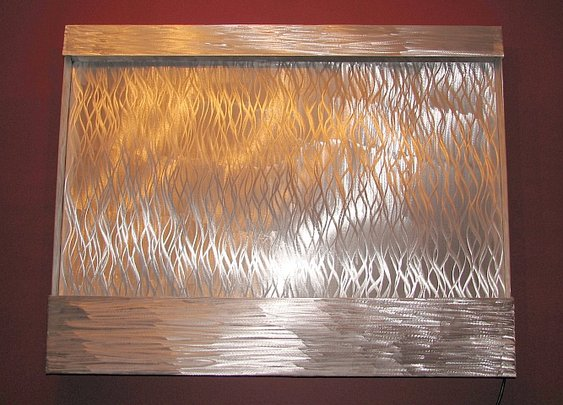 water fountain in abstract design and made of aluminum