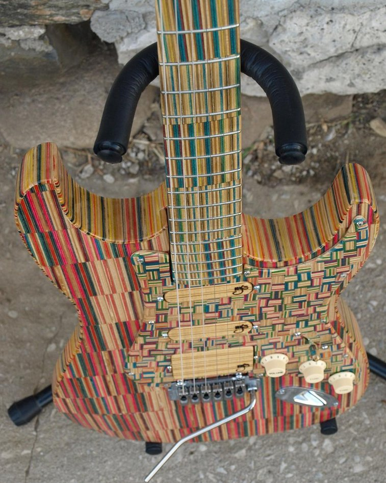 A Beautiful Multi-Colored Hand-Built Custom Electric Guitar Made From Recycled Skateboards