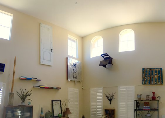 "Guy hangs ""art"" from anything in garage that can't be given away"