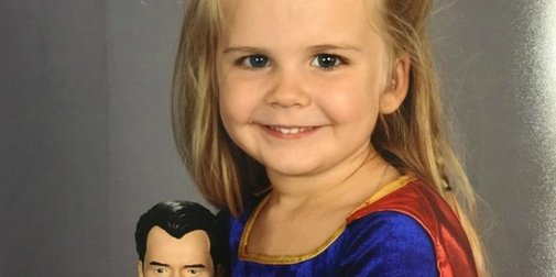 Dad let's daughter pick what to wear for school picture day.
