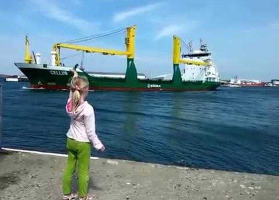 Girl honks at ship