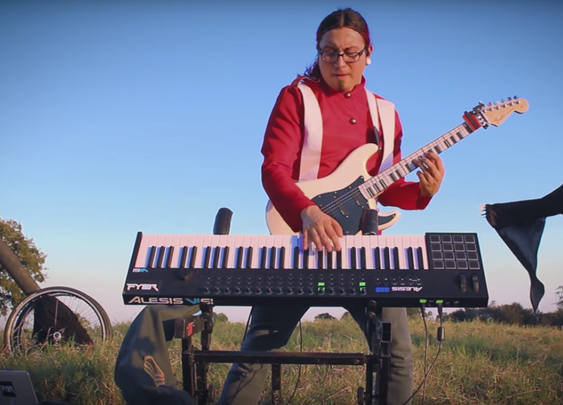 Watch this man cover The Trooper on guitar and synth at the same time