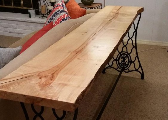 A Table Made From a Wood Slab and an Old Sewing Machine Base
