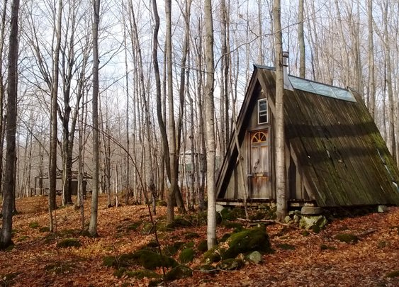 A-frame nestled on a limestone ridge deep in the maple forest in Ontario, Candada