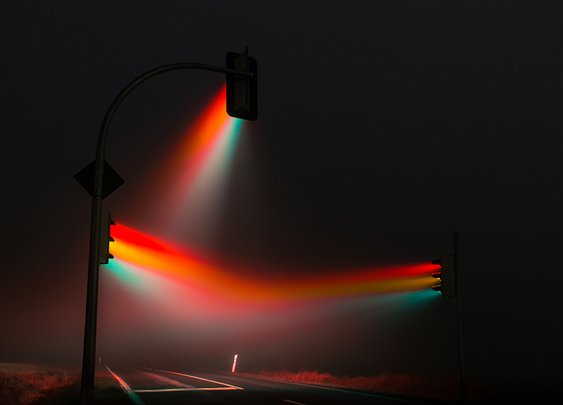 lucas zimmermann's traffic lights illuminate misty streets