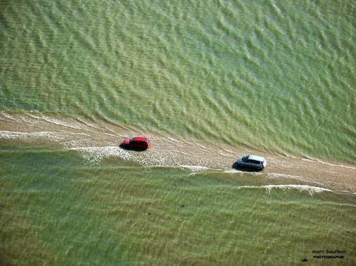 Disappearing Road: Cross Quickly, Before It's Swallowed by the Sea Again