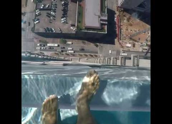 A Glass bottom pool with the horrifying view.. not a chance in heck :)