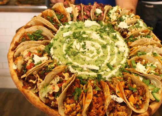 This Massive Pizza is Topped with Tacos and Guacamole