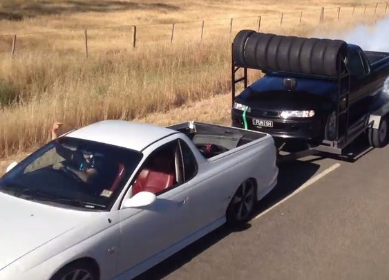 Watch Humanity Peak As a Ute Does a Burnout While Being Towed by Another Ute