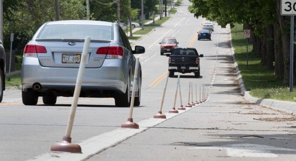 Some Cyclists in Omaha Improved a Bike Lane With 120 Plungers - Atlas Obscura