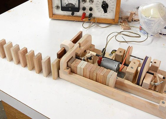 Wooden domino row building machine - YouTube