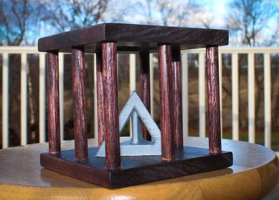Caged Tetrahedron Puzzle: 13 Steps