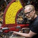 Adam Savage Upgrades a Nerf Rival Nemesis Blaster to Fire 1,000 Soft Plastic Balls