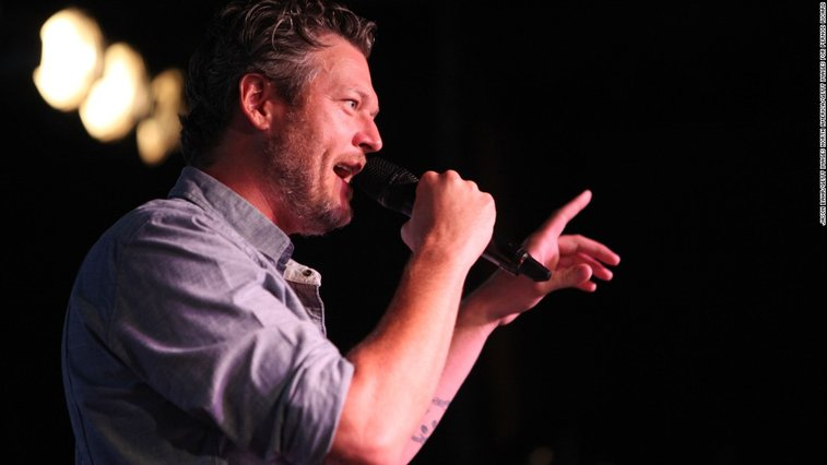 Blake Shelton fell on stage and asked fans for video