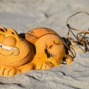 For decades, Garfield telephones kept washing ashore in France. Now the mystery has been solved.