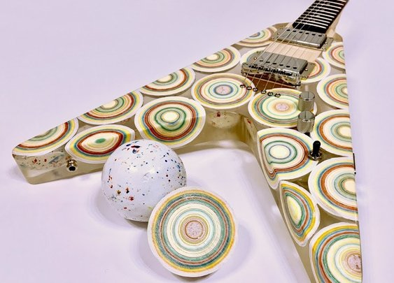 Craftsman Builds a Flying V Electric Guitar Using Eight Mega Jawbreakers