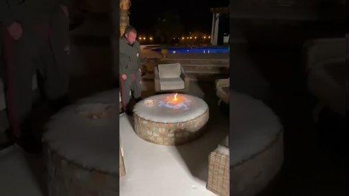 Guy Lights Frozen Fire Pit - YouTube